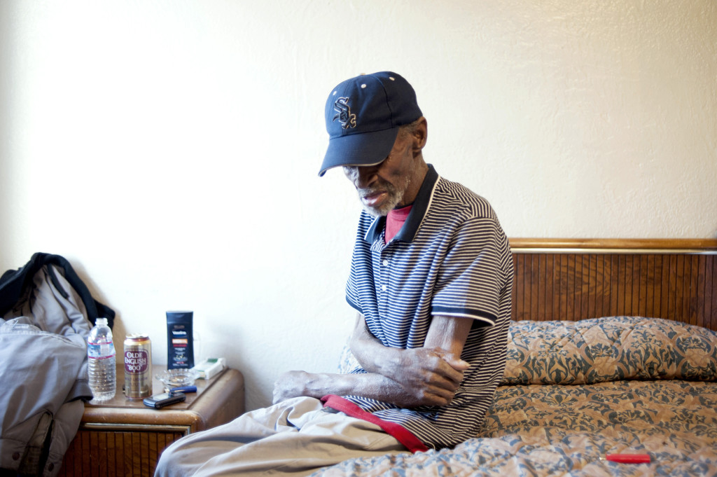 ALISSA AMBROSE/STAT--Foreman rests in an $80 motel room in East Oakland. His monthly income is about $500, and he can rarely afford such luxury.