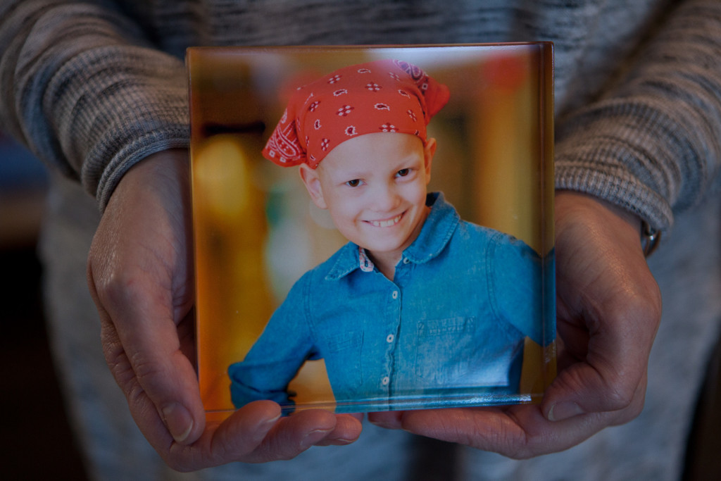 "Portsmouth, NH -- 01/21/16 -- Paula Skelley displays a photograph of her daughter Lydia Valdez, on January 21, 2016, in Portsmouth, New Hampshire. Lydia was 8 years old in this photograph, which was taken for her participation as a ""pedal partner"" in the Pan-Mass Challenge. (Kayana Szymczak for STAT)"