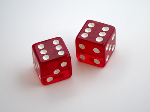"Two red dice with side ""six"" facing up."