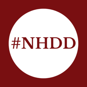 """#NHDD"" written on a white circle over maroon background"